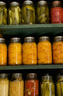 Close-up of pickle jars by Panoramic Images