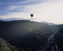 Silhouette of a hot air balloon in the sky, Taos County, New Mexico, USA von Panoramic Images