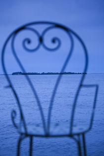 Small island viewed through a chair von Panoramic Images
