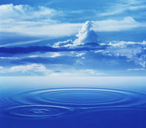 Dramatic cloud formations above rings in deep blue water by Panoramic Images