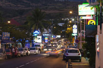 Traffic on a street at night by Panoramic Images