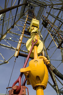 Low angle view of a drilling rig by Panoramic Images