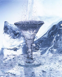 Water pouring into champagne glass with icy background by Panoramic Images