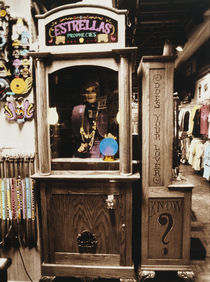 Fortune teller machine in a store by Panoramic Images
