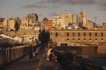 People on a pier, Escollera Sarandi, Montevideo, Uruguay by Panoramic Images