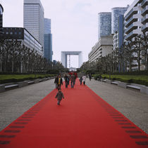 Group of people walking on a carpet in front of a monument by Panoramic Images