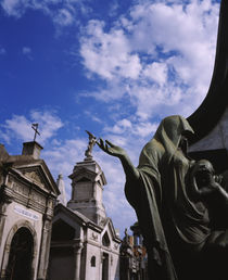 Low angle view of a statue in a cemetery by Panoramic Images