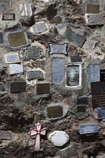 Memorial plaques on a stone wall at a shrine by Panoramic Images