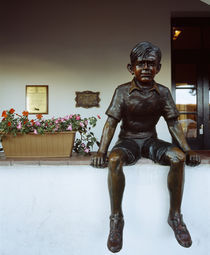 Statue of a boy on a ledge, Birthplace of Che Guevara, Rosario, Argentina by Panoramic Images