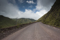 Road passing through mountains by Panoramic Images