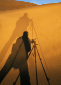 Photographer's Shadow On Sand Dunes by Panoramic Images