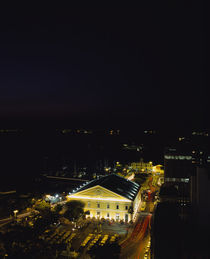High angle view of a building lit up at night by Panoramic Images