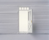 Open white door floating plaster wall by Panoramic Images