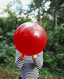 Close-up of a woman blowing a balloon, Germany von Panoramic Images
