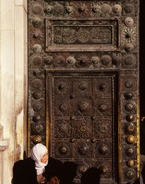 Woman in front of a closed door, Syria by Panoramic Images