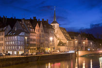 Buildings lit up at dusk, St. Nicholas Church, Alsace, Strasbourg, France by Panoramic Images