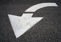 Traffic Arrow Painted On Road von Panoramic Images
