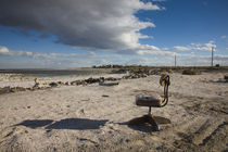 Empty chair on a coast by Panoramic Images