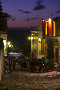 Buildings lit up at dusk, Calle De La Playa, Colonia Del Sacramento, Uruguay von Panoramic Images