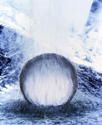 Water cascading over crystal sphere in crashing waves by Panoramic Images