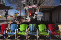 Multi-colored chairs at a sidewalk cafe by Panoramic Images