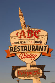 Low angle view of a restaurant sign by Panoramic Images