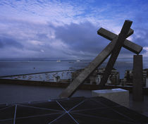 Cross sculpture on the top of a building, Salvador, Brazil von Panoramic Images