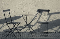 Table and chairs at a sidewalk cafe, Colonia Del Sacramento, Uruguay by Panoramic Images