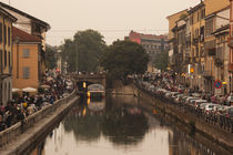 Cafes and restaurants along a canal, Naviglio Grande, Milan, Lombardy, Italy by Panoramic Images