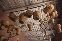 Wicker baskets and dreamcatchers hanging in a restaurant von Panoramic Images