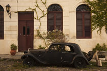 Vintage car parked in front of a house by Panoramic Images