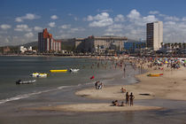 Tourists enjoying on the beach, Playa Piriapolis, Piriapolis, Maldonado, Uruguay von Panoramic Images