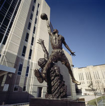 Low angle view of a statue in front of a building by Panoramic Images