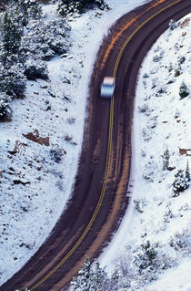 Birds-eye view of car on park road, snow, Zion National Park, Utah, USA. by Panoramic Images