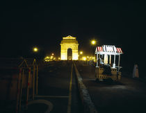 India Gate with Ice cream vendor at night, New Delhi, India by Panoramic Images