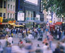 Crowd standing in front of a movie theater, Theater District, London, England by Panoramic Images