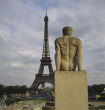 Statue of a naked man in front of a tower, Eiffel Tower, Paris, France by Panoramic Images