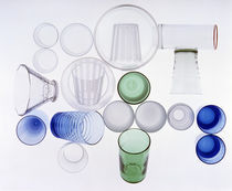 Arrangement of clear, blue and green glass cups, plates, bowls and glasses von Panoramic Images
