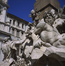 Low angle view of statues on a fountain by Panoramic Images