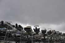 Motor Boats on racks at harbor by stormy sky by Sami Sarkis Photography