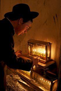Jerusalem, lighting Hanukkah candles by Hanan Isachar