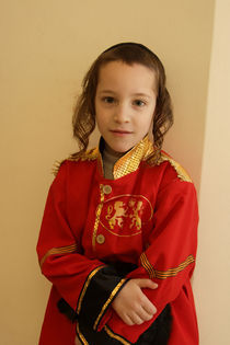 Purim holiday, Hassidic boy in costume by Hanan Isachar