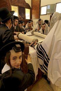 Purim holiday, the Rabbi is reading the Torah by Hanan Isachar