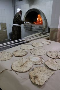 Matzot  Baking on Passover eve by Hanan Isachar
