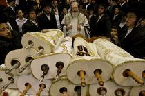 Simchat Torah celebration, the Rebbe with the Torah scrolls by Hanan Isachar