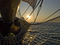 Tall ship at sunset by Xabier Armendariz