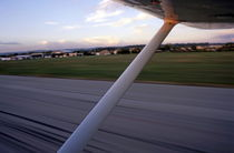 Wing of a private plane landing at the airport