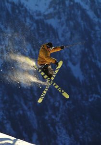 Skier jumping into the air. by Ross Woodhall