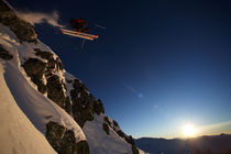 Skier jumping off a cliff.