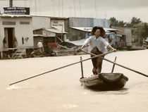 Vietnamese woman rowing a boat in Mekong River in Vietnam by dreamyfaces